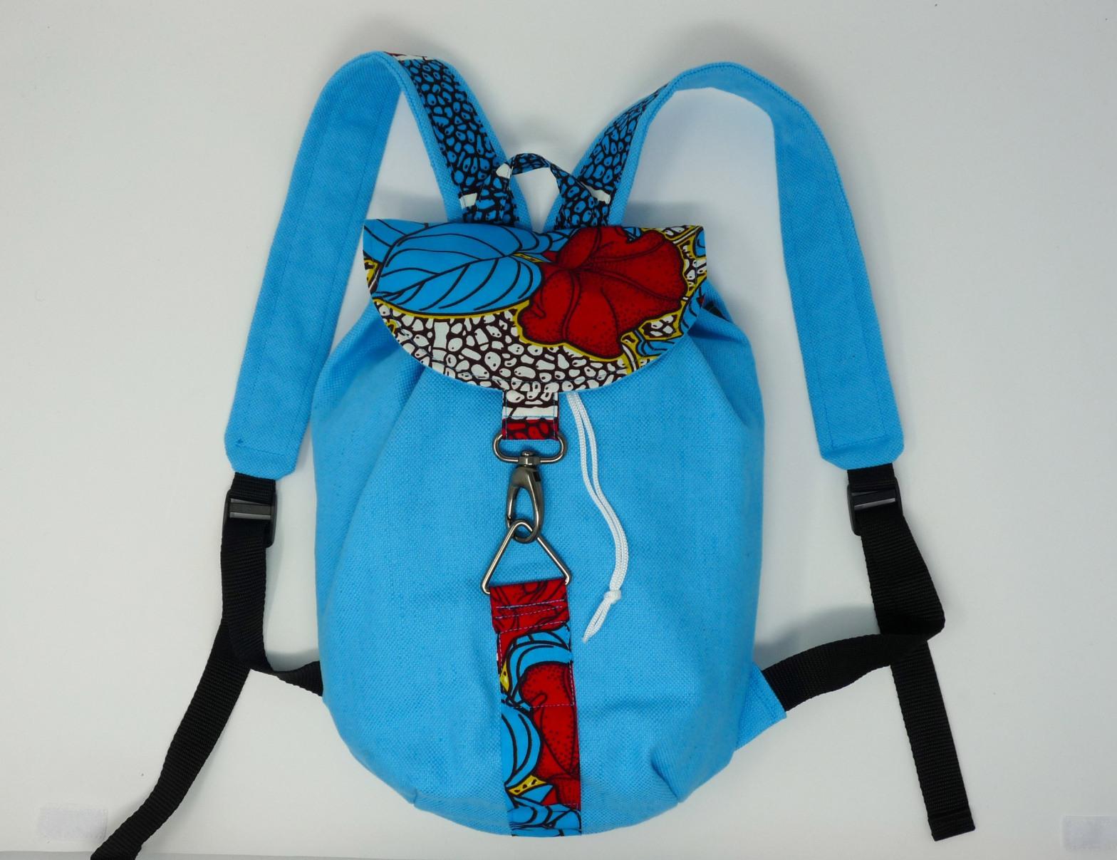 Sac à dos turquoise et pagne rouge et turquoise