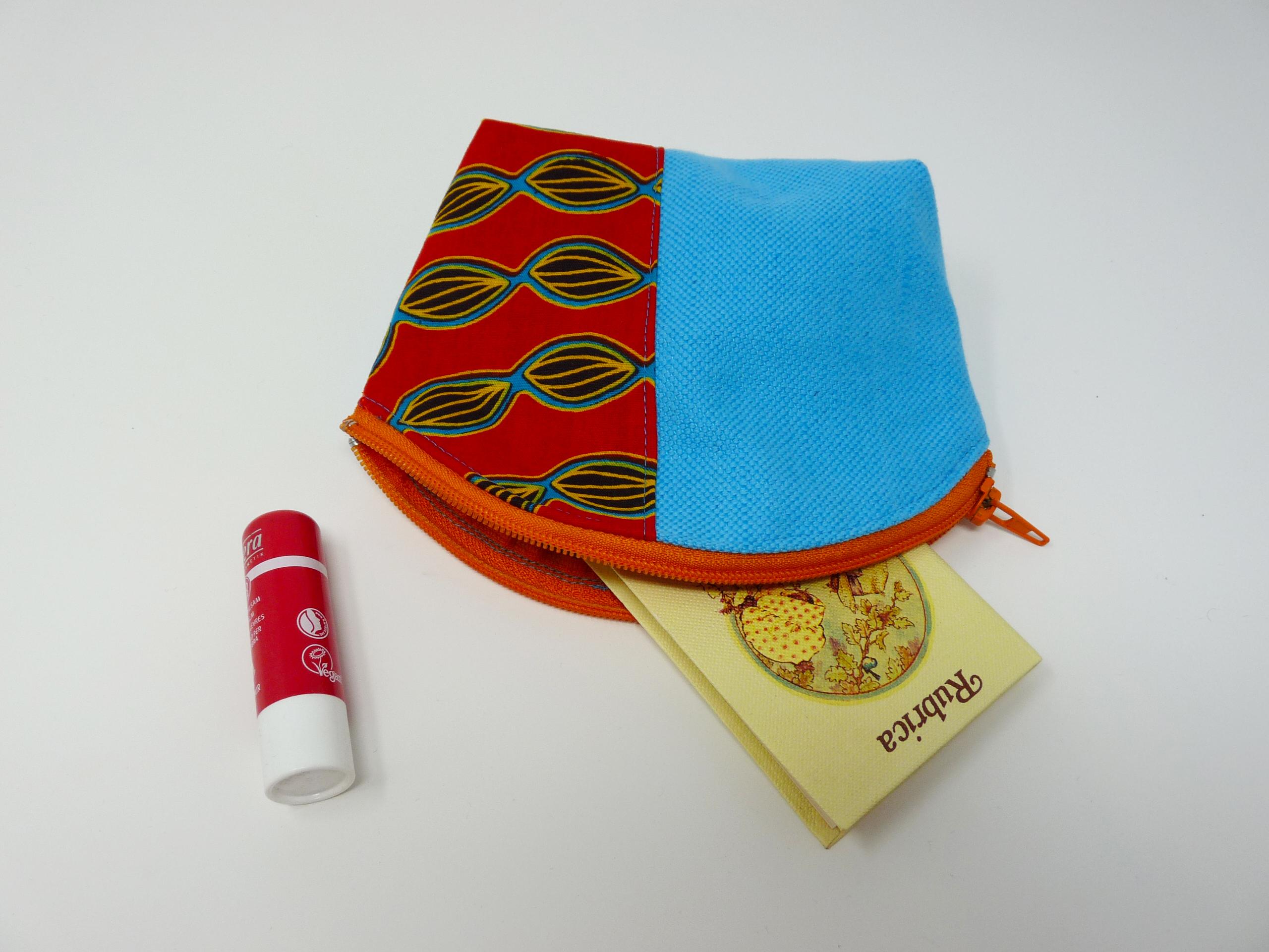 Trousse turquoise avec tissu africain rouge